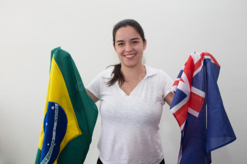 Woman with flags in the white background royalty free stock image