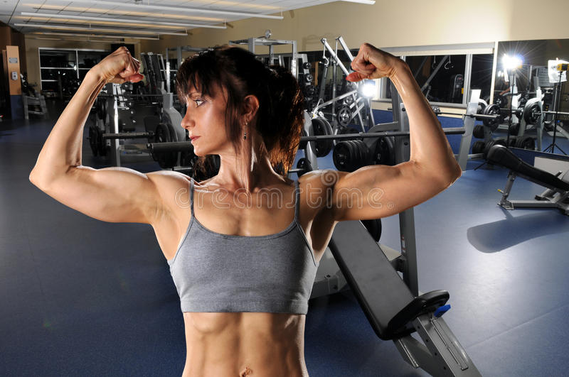 Woman Flexing At The Gym Royalty Free Stock Images