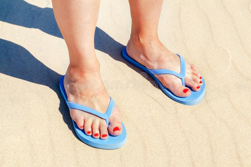 Woman in flip flops on beach royalty free stock photography