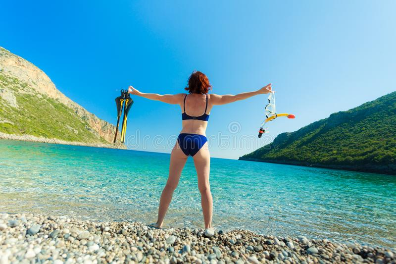 Woman with flippers snorkeling tube on beach stock image