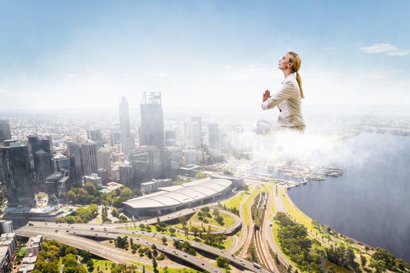 Woman float above city . Mixed media stock image