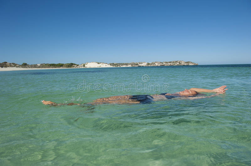 Download Woman Floating And Relaxing In Ocean Stock Image - Image: 20109261