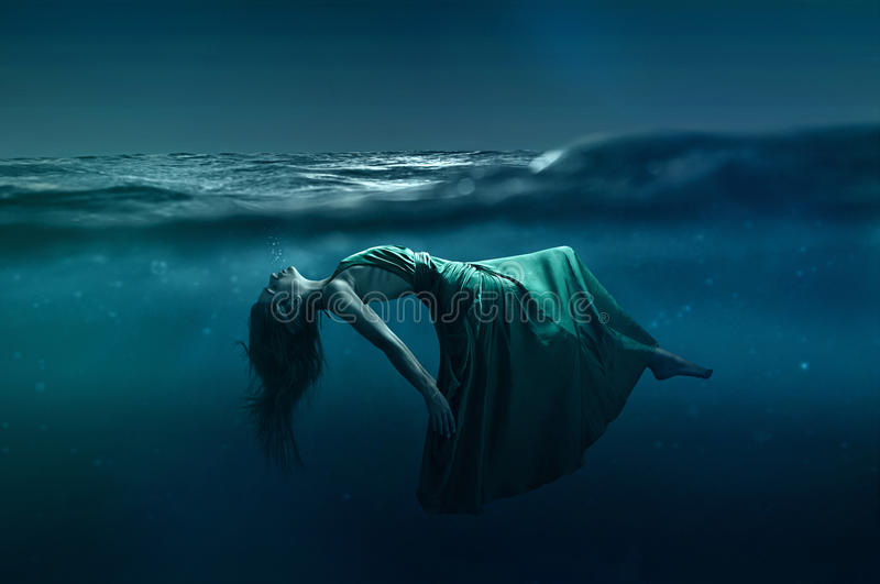 Download Woman floating under water stock photo. Image of fashion - 50176128
