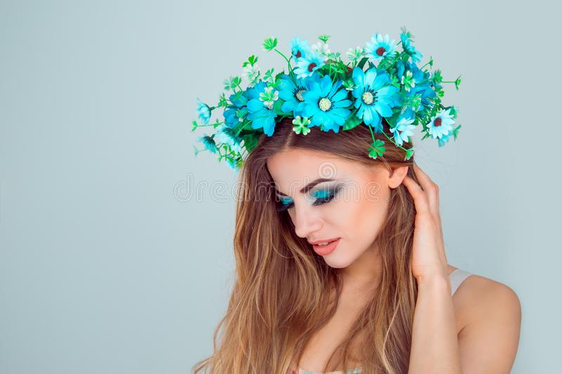 Woman floral crown with floral crown on head in side profile royalty free stock photos