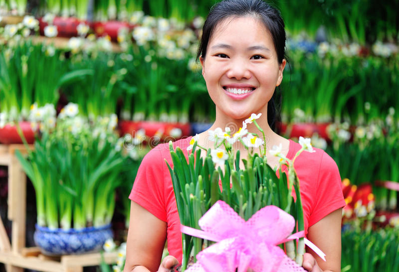 Woman florist with daffodil flower stock photography