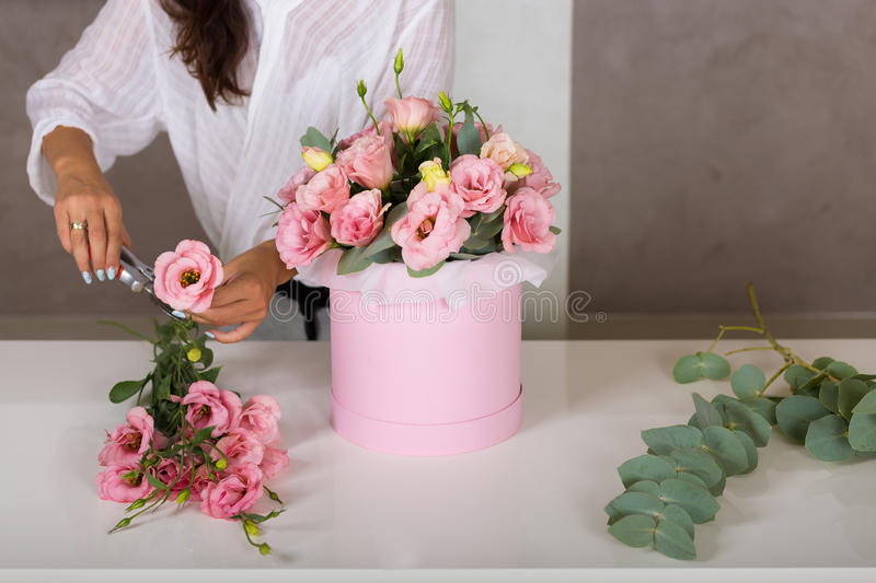 Woman florist making a lovely flower composition stock photography