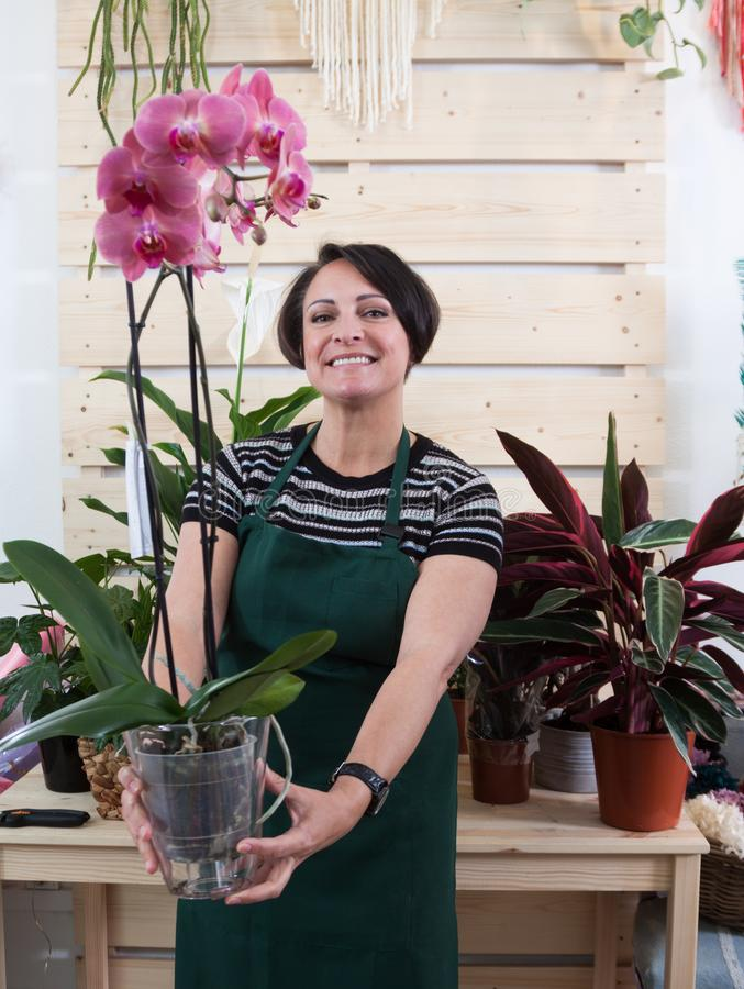 Portrait Of Woman Florist With Orchid Phalaenopsis In ...