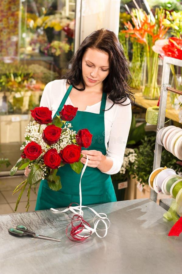 Woman florist working flowers roses market making stock photos