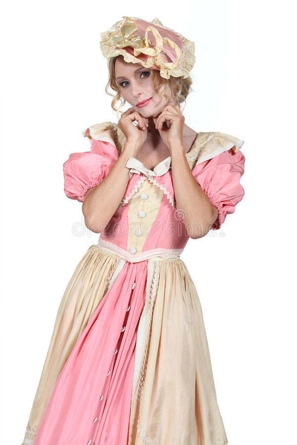 Woman in flouncy period dress. Woman in a flouncy period fancy dress costume royalty free stock photography
