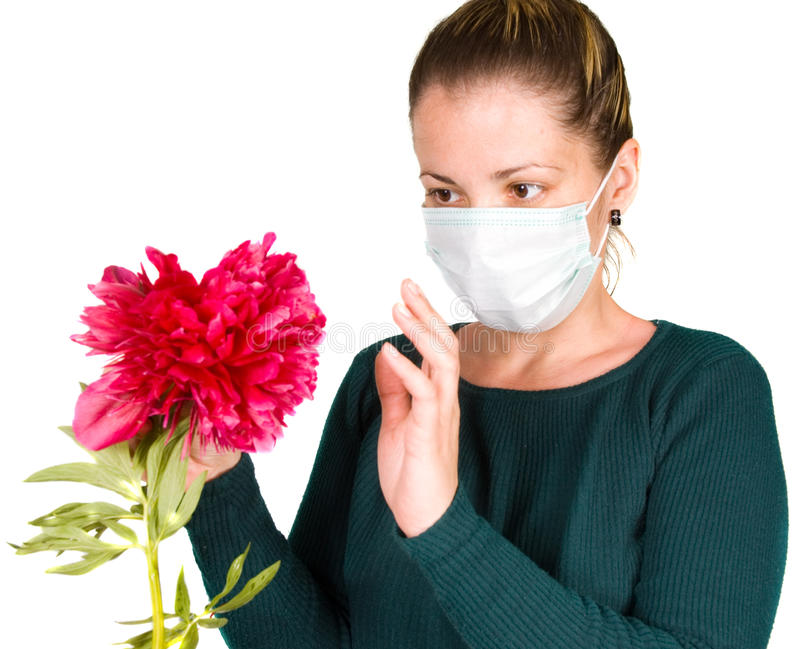 Woman with flower. allergy stock photography