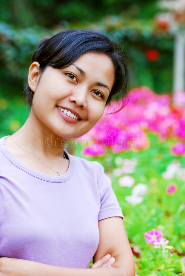 Woman at the flower garden royalty free stock photos