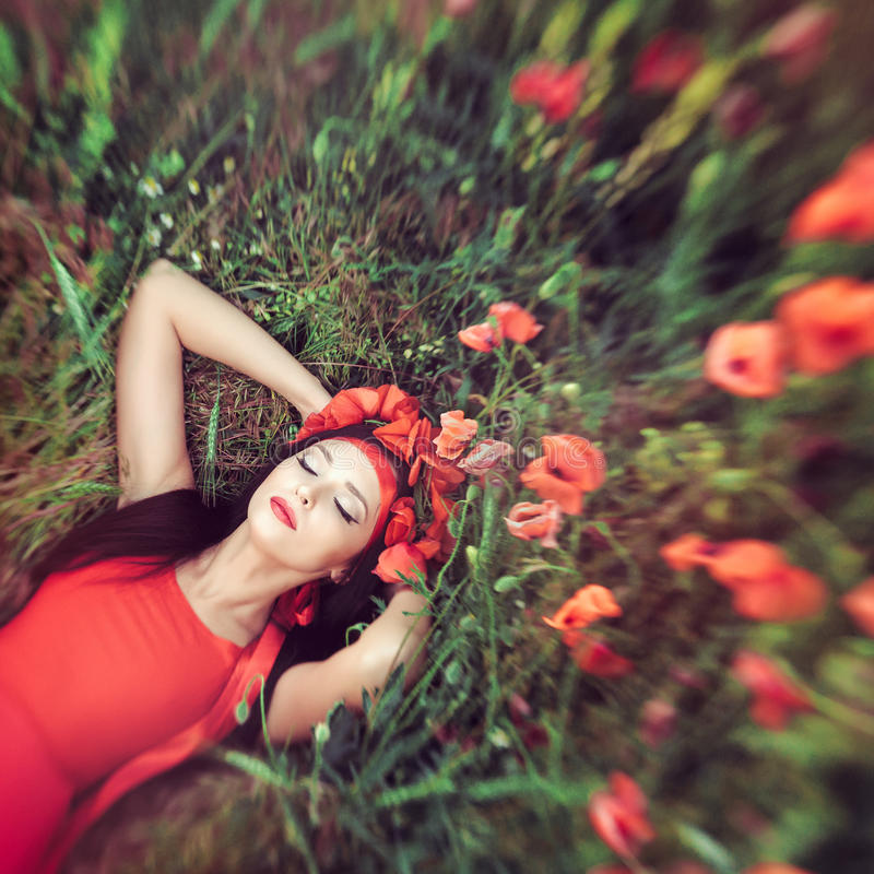 Woman in flower poppy field in summer royalty free stock images