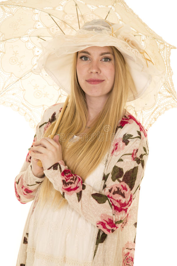 Woman flower shirt hat and umbrella close stock images