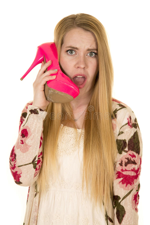 Woman flower shirt pink shoes talk like phone stock photography