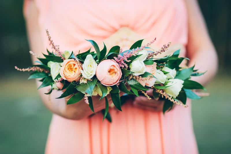 Woman with flower wreath in her hands stock photography