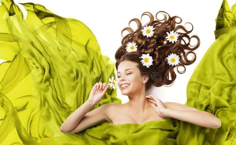 Woman Flowers in Hair Curls, Beauty Model Floral Hairstyle. Girl Smell Daisy Flower, Flying Fluttering Green Dress Fabric stock photos