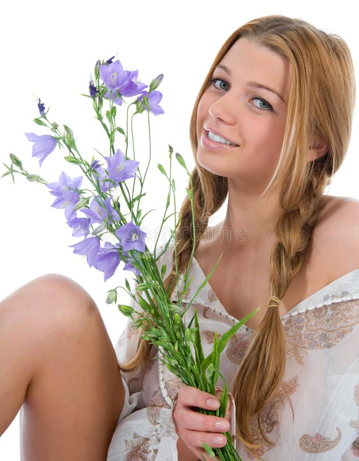 Woman with flowers on white stock photo