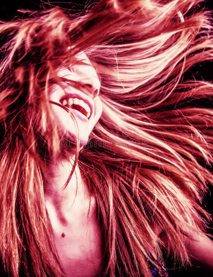 Woman with flowing hair. A portrait of a woman with her hair flowing stock image
