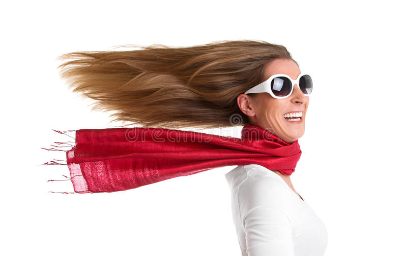 Woman with flowing hair. Wind - isolated woman with flowing hair in red royalty free stock photos