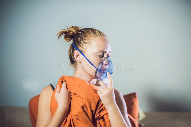 Woman with flu or cold symptoms making inhalation with nebulizer - medical inhalation therapy.  stock images