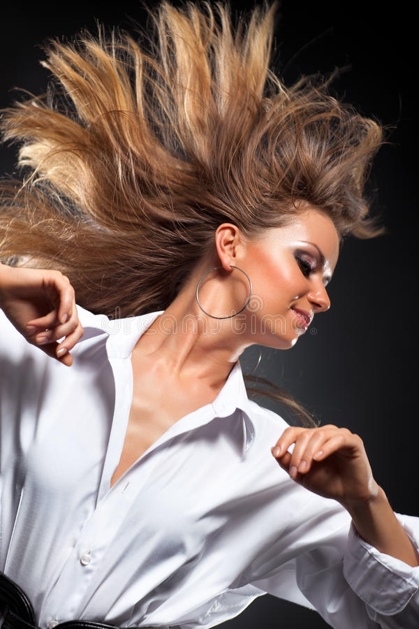 Woman with fluttering hair stock image