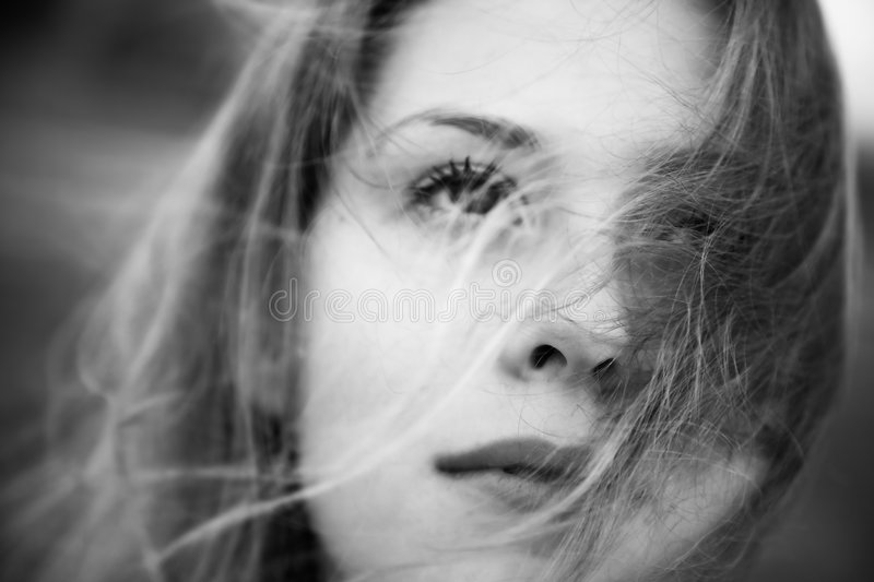 Woman with fluttering hair concept bw portrait