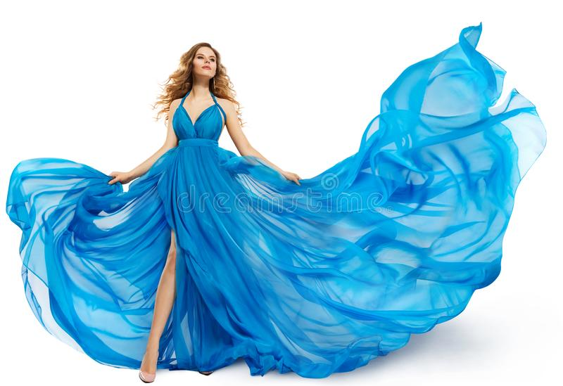 Woman Flying Blue Dress, Fashion Model Dancing in Long Waving Gown, Fluttering Fabric on White. Woman Flying Blue Dress, Fashion Model Dancing in Long Waving royalty free stock images