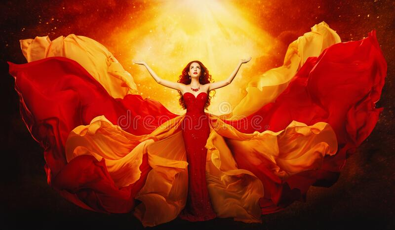 Woman in Flying Dress Raised Arms to Mystery Light, Girl in Red Gown. Woman in Flying Dress Raised Arms to Mystery Light, Fantasy Goddess in Red Fluttering Gown stock photography