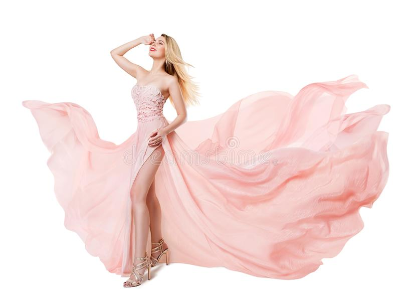 Woman Flying Pink Dress, Fashion Model in Long Waving Gown, Fluttering Fabric royalty free stock image
