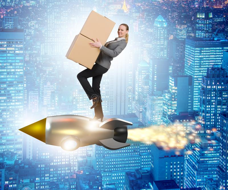 Woman flying rocket and delivering boxes stock images