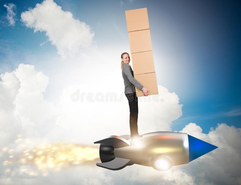 Woman flying rocket and delivering boxes stock image