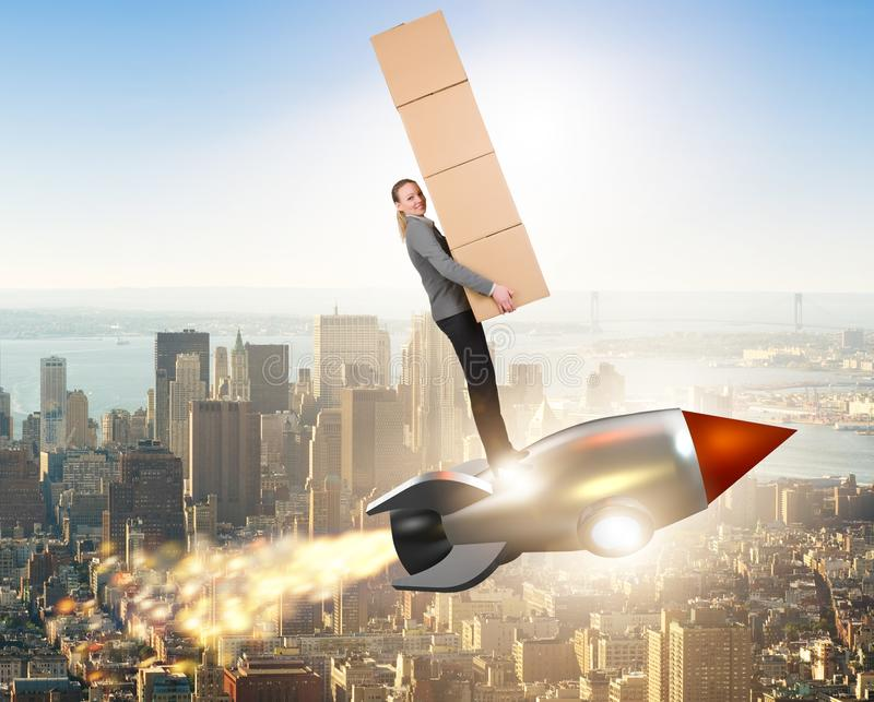 Woman flying rocket and delivering boxes stock photo