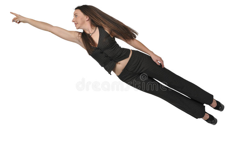 Woman Flying Through the Sky. Beautiful young woman flying through the sky stock photography
