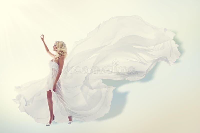 Woman Flying White Dress, Elegant Fashion Model Gown royalty free stock photos