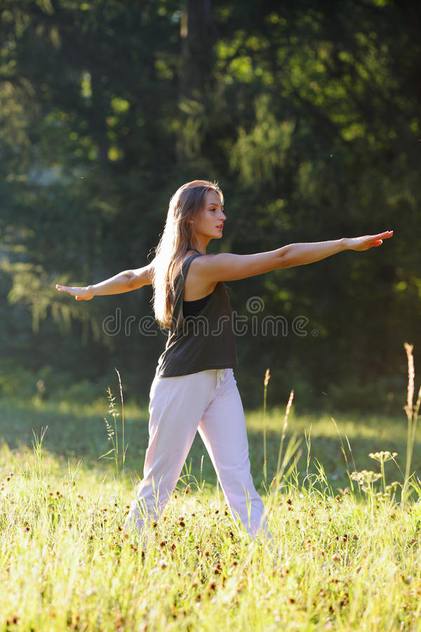 Woman focuses on the exercise of yoga. Healthy lifestyle royalty free stock photo