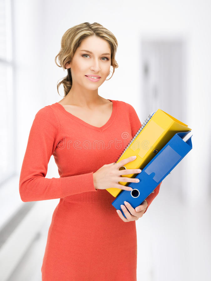 Woman with folders. Bright picture of beautiful woman with folders stock images