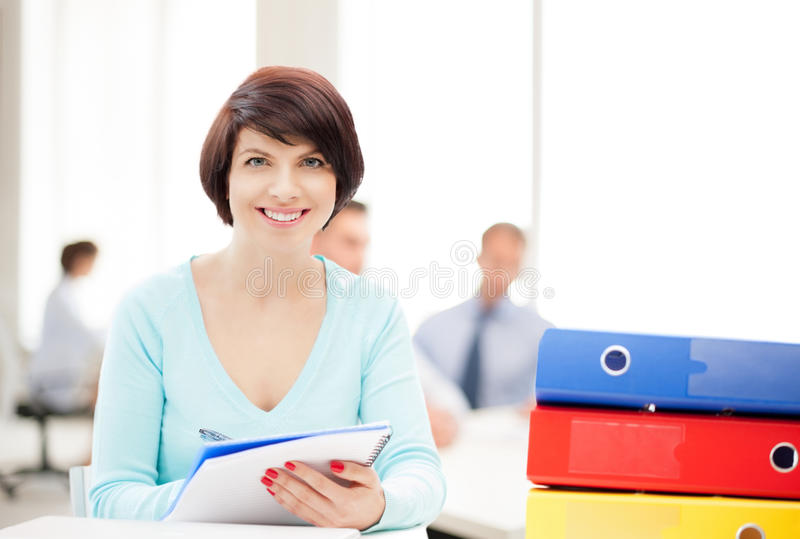 Woman with folders. Business and education concept - woman with folders stock image