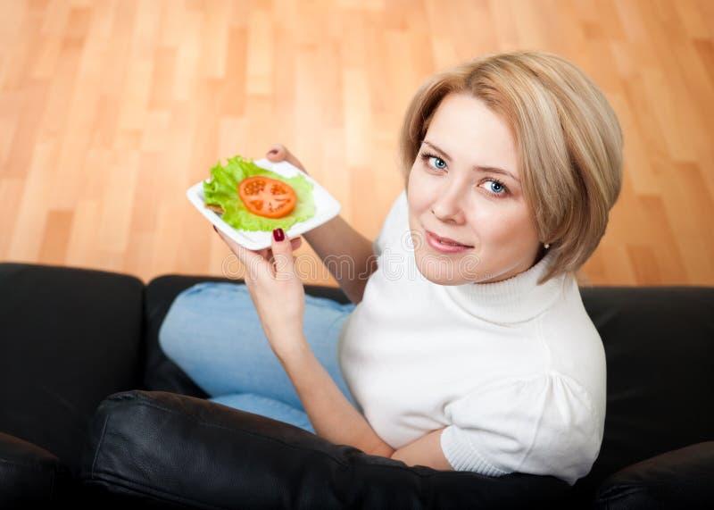 Woman follow healthy lifestyle. Eating fresh stock photo