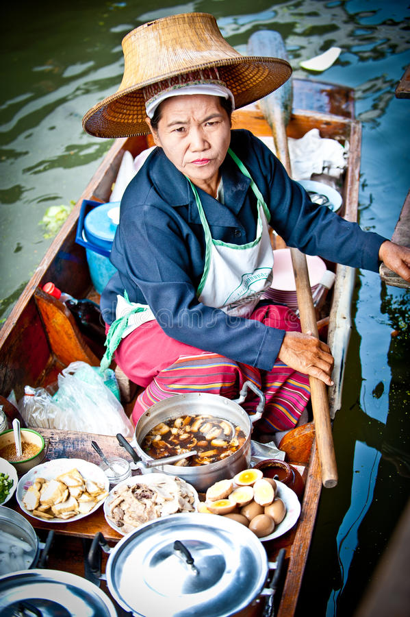 Woman food seller in bangkok floating market royalty free stock images