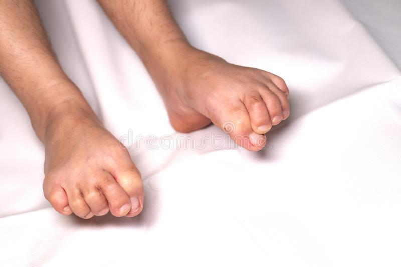 Woman foot flexion on bed sheets royalty free stock photo