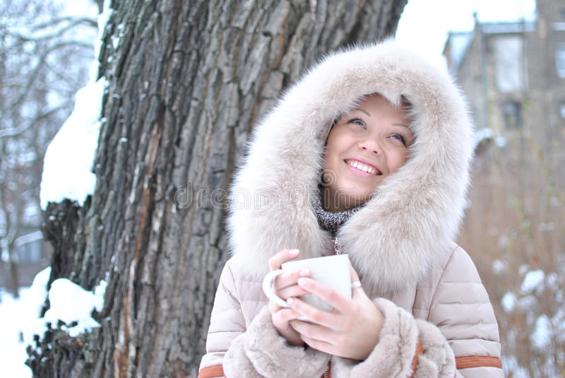 Woman forest drink hot winter tea royalty free stock image