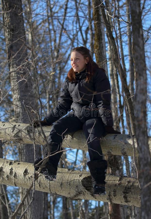 Woman in forest during winter royalty free stock photography