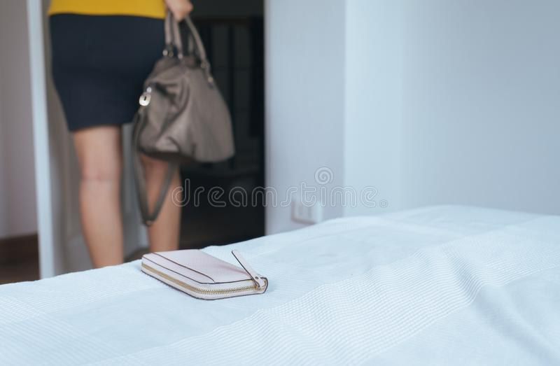 Woman forgot her wallet on bedroom while going to work. In morning stock photos