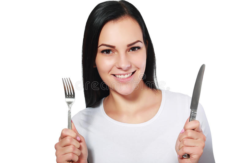 Woman with fork and knife stock images