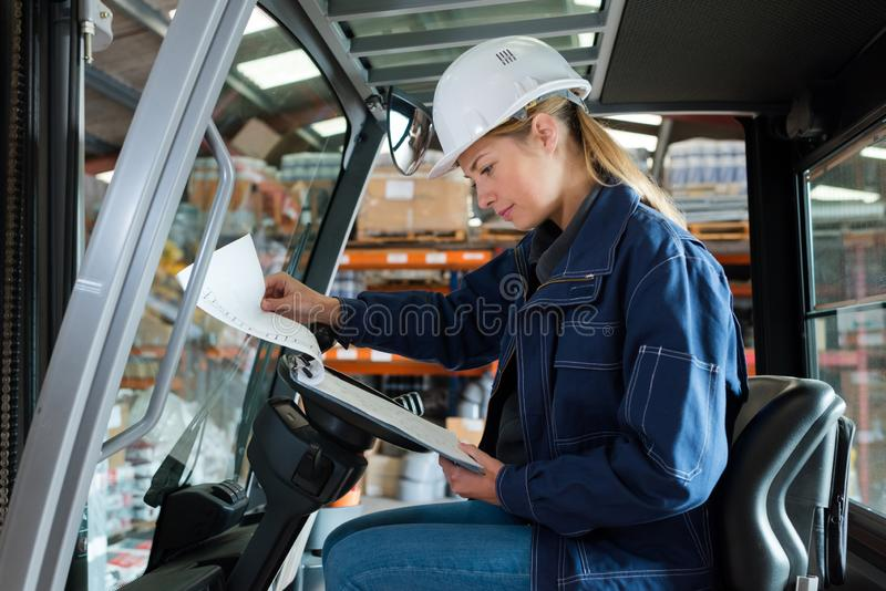 Woman on forklift truck. Woman royalty free stock photos