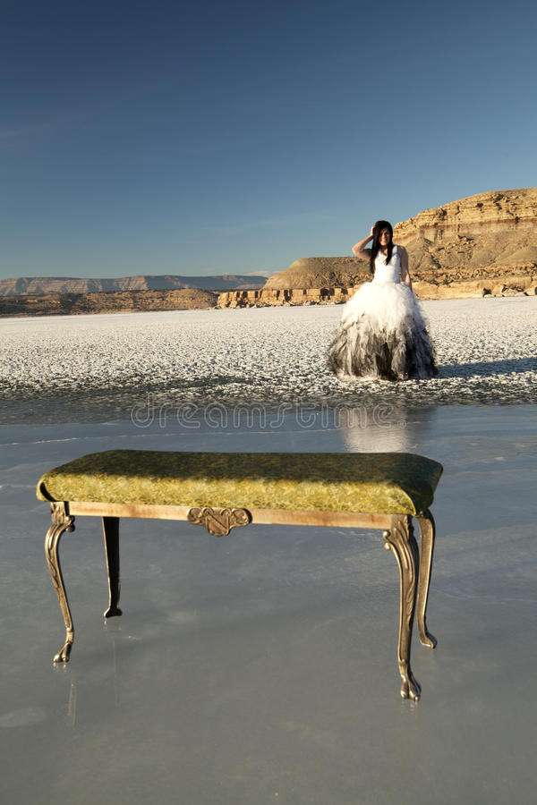 Woman formal dress ice bench royalty free stock photography