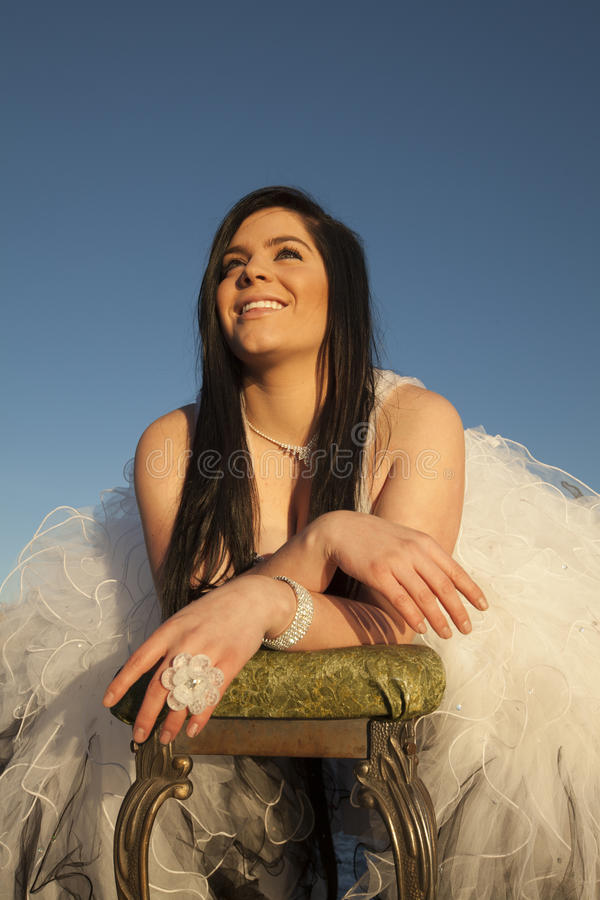 Woman formal dress ice smile look up bench royalty free stock photos