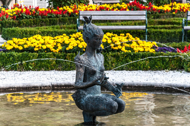 Woman fountain in Mirabell Gardens royalty free stock photography