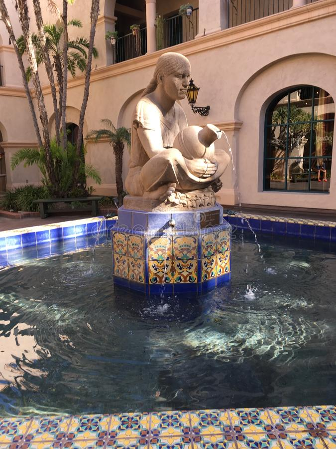 Woman Fountain. Pouring water from ceramic jug into pool with yellow and blue tiles in Balboa Park, San Diego Spanish style stock photography