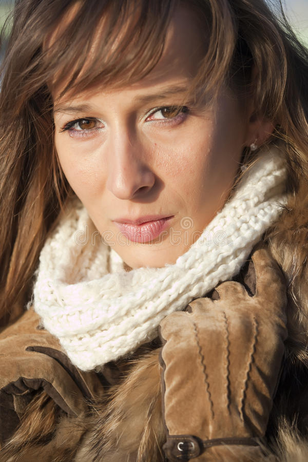Woman in fox coat and scarf. Portrait of woman in fox coat and scarf royalty free stock photography
